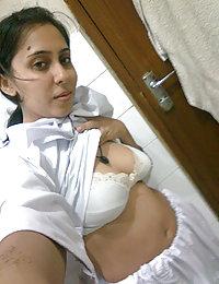 hot indian girl posing in bedroom