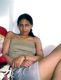 indian in her night suits posing on camera